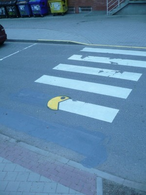 Pac Man eating street paint